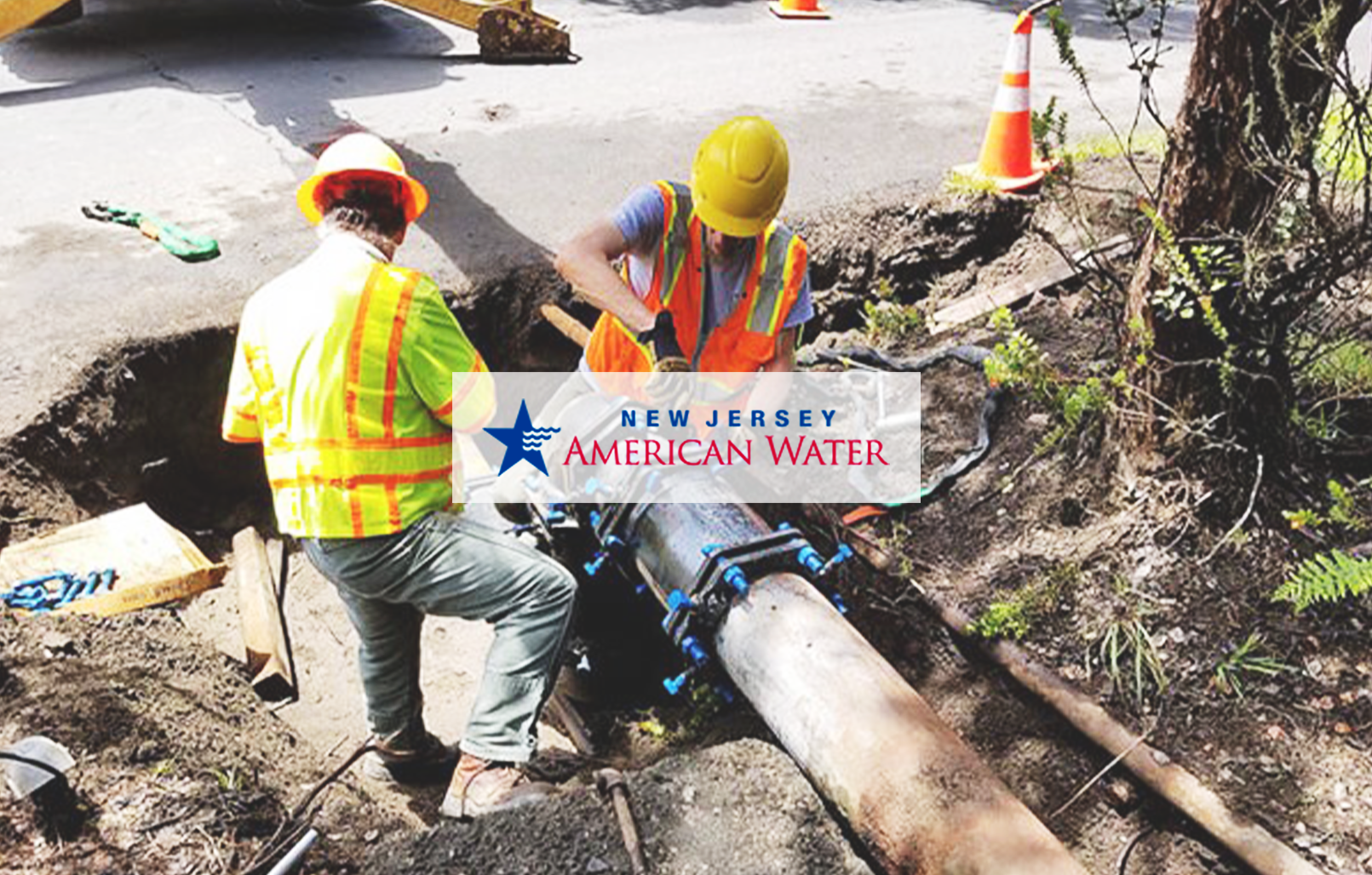 Image of two men repairing a water main with the New Jersey American Water logo on top