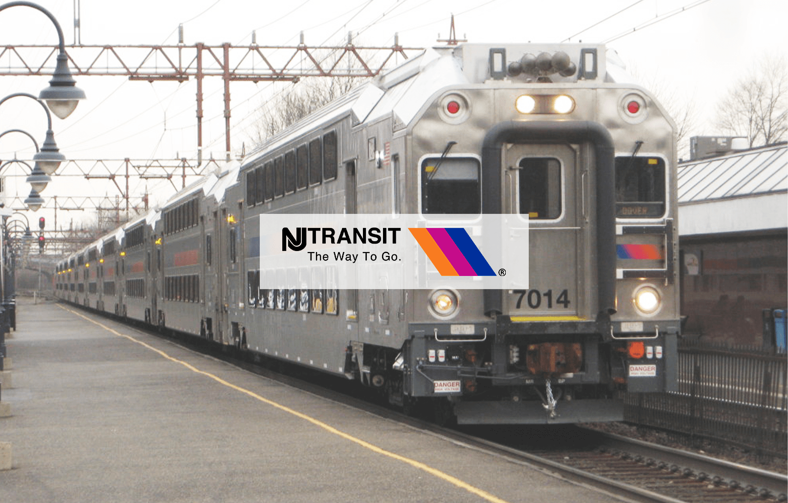 New Jersey Transit Double Decker Train at Millburn Train Station with NJ Transit logo on top