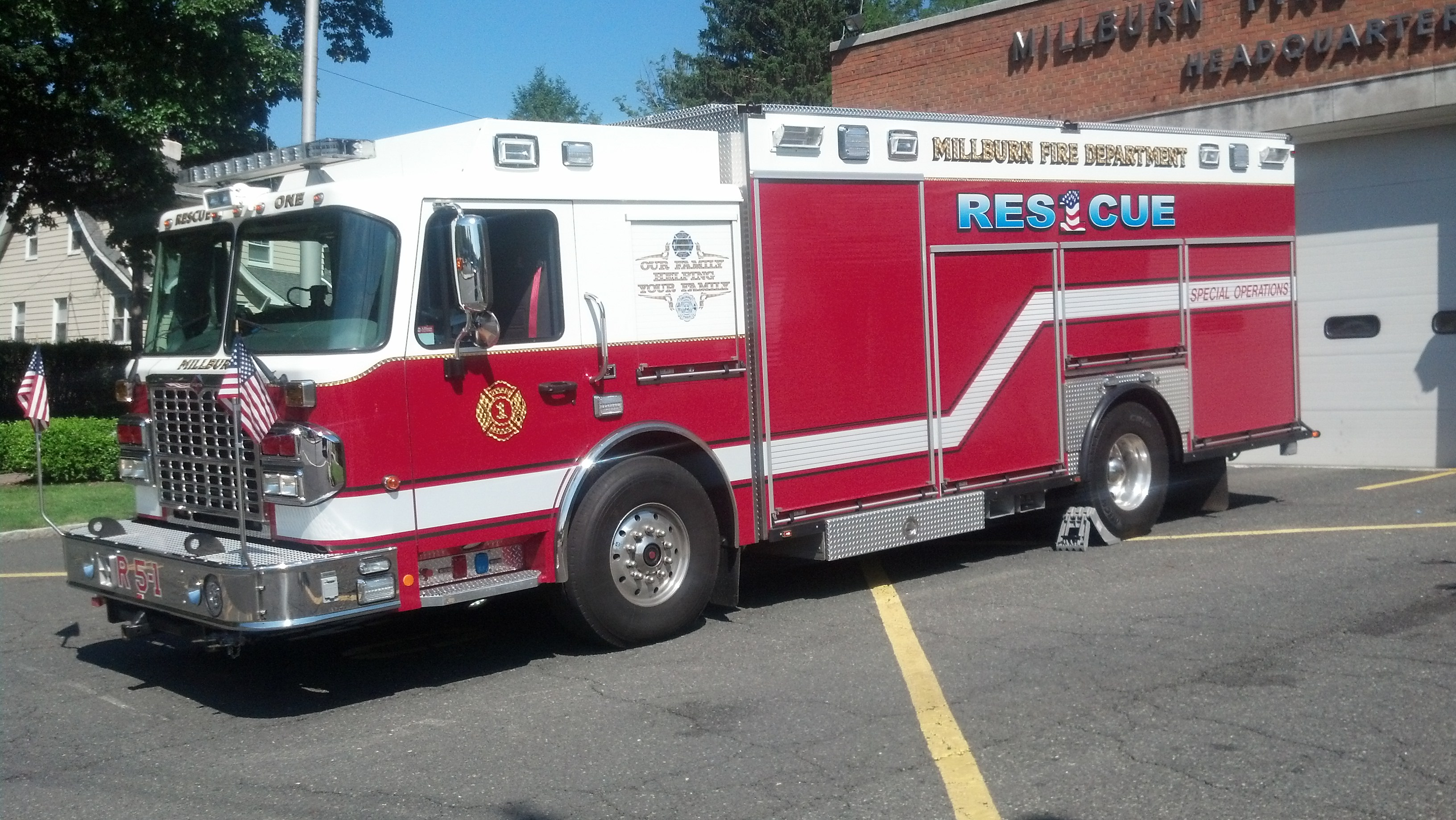 A red and white rescue engine with Rescue 1 on the side